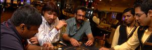 Indian players gambling at table