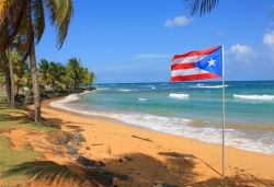 Puerto Rico beach with flag